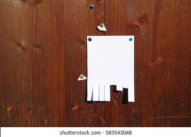 tear off paper on wooden background