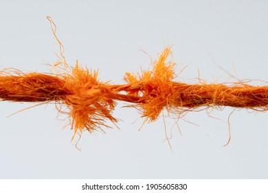 Tear test of a red thread closeup