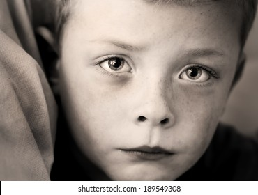 tearful small boy with a look of true sadness