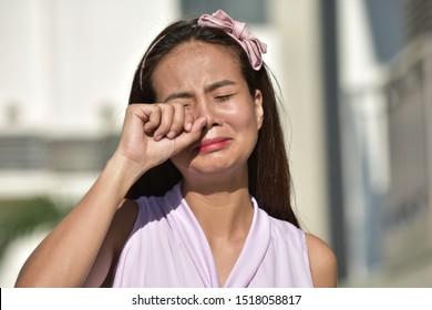 A Tearful Young Filipina Woman