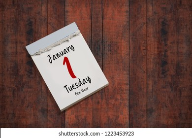 tear-off calendar with 1st of january 2019 on wooden background