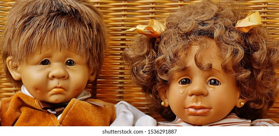 Tears are coming out of cute babies doll eyes, Dolls are sad scene view.