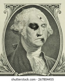 A teary eyed and severely beaten George Washington on a dollar bill representing a weakened and sagging U.S. economy.
