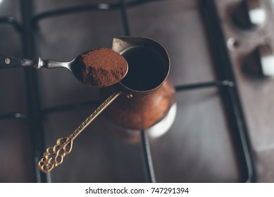 Teaspoon of coffee over old coffee pot