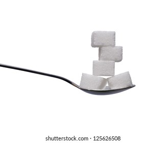 Teaspoon with sugar cubes on white background