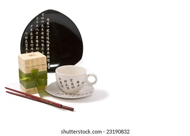 Tea-things in asian style with hieroglyphics. Isolated on white. Path included
