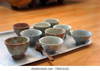 Tea-Time: Ceramic Tea Cups with Wooden Spoon on Metal Tray, Ready for a Group Chat in a Circle