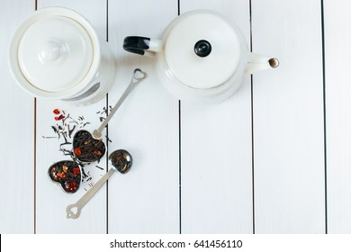Teatime flat lay. Loose leaf tea ,infuser, tea pot and vintage spoons View from above