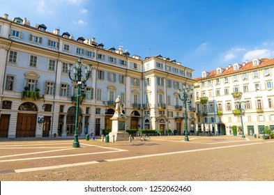 Teatro Carignano theatre building, Vincenzo Gioberti monument and street lamps on Piazza Carignano square in historical centre of Turin Torino city in beautiful summer day, Piedmont, Italy