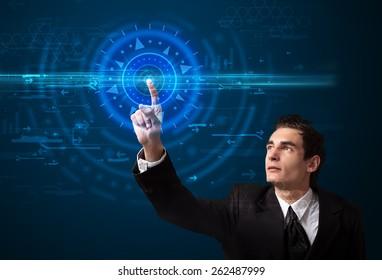 Tech guy pressing high technology control panel screen concept