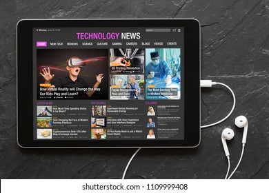 Tech news website on tablet. All contents are made up.