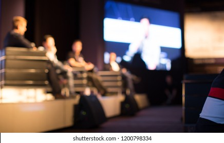 Tech Panel on Stage during Discussion Event. Experts Debate during Business Conference Seminar Presentation. Executives and Entrepreneur Speakers and Presenters in Conference Hall Lecture Series.