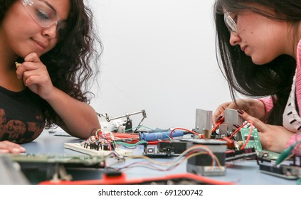 Tech students rigging up printed circuit boards