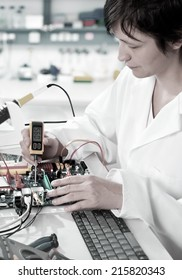 Tech tests electronic equipment in hardware service facility