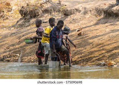 TECHIMAN, GHANA - JAN 15, 2017: Unidentified Ghanaian children get water on the Washing Day, which is every Sunday