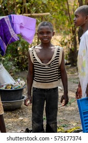 TECHIMAN, GHANA - JAN 15, 2017: Unidentified Ghanaian girl smiles in a village. Ghana people suffer of poverty due to the bad economy