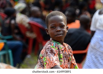 TECHIMAN, GHANA - JAN 15, 2017: Unidentified Ashanti little boy in colored shirt looks ahead in the local village. Ashante are ethnic group of Ghana