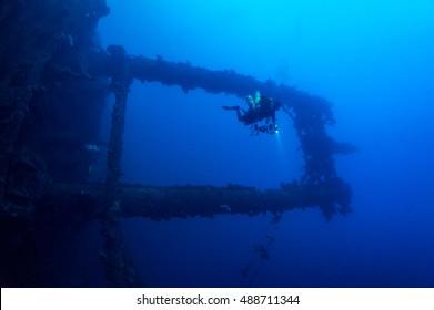 Technical dive observes masts of sunken WW2 shipwreck Amagisan Maru at Truk lagoon