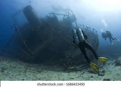Technical diver with twin set stand by to see whole ship wreck of Ghianis D, Red Sea, Egypt