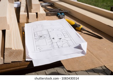 Carpenter working technical drawing blueprint construction stock technical drawing or blueprint construction paper lying on a workshop outdoor desk with carpentry tools malvernweather Images