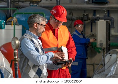 Technical Manager Using Digital Tablet and Discussing About Production Process with Power Plant Worker. District Heating Power Plant. Digital Technology and Teamwork Concept. Industry 4.0  - Shutterstock ID 1930613504