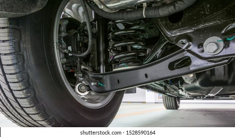 Technical photo. The structure of the modern car. Rear suspension. Shock absorber. Spring suspension.