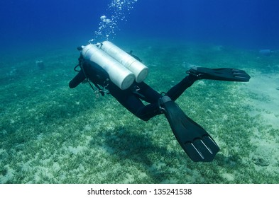 technical  scuba diver in clear blue water