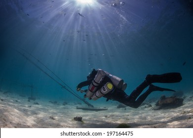 technical scuba diver in the shallows