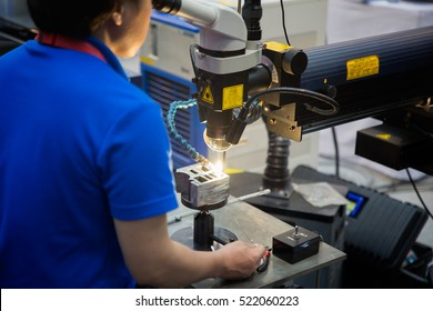 Technical Specialties and engineer repair mold and die part by Laser welding machine, production, worker and factory job , Spot welding Industrial automotive in thailand