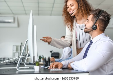 Technical support agents working in office