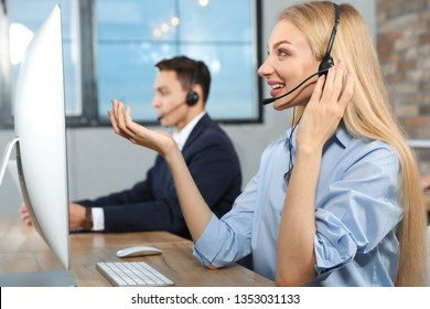 Technical support operator with colleague in modern office