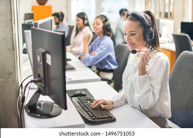 Technical support phone operators in headset working in call centre