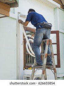 Technician of the air conditioning system is working on installing a new air conditioner.