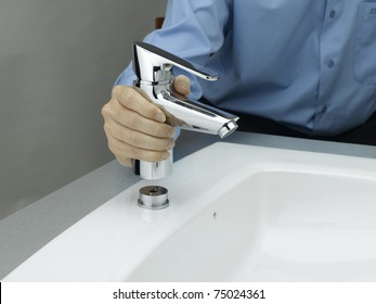 Technician is assembling the water supply faucet