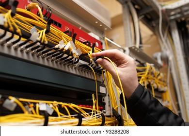 The technician attaching fiber optic on the telecom site