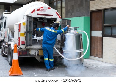 Technician with car nitrogen and fill liquid nitrogen in storage tank