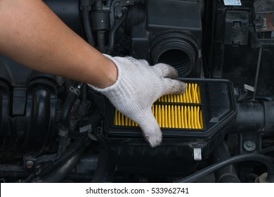 Technician is changing new air filter for car