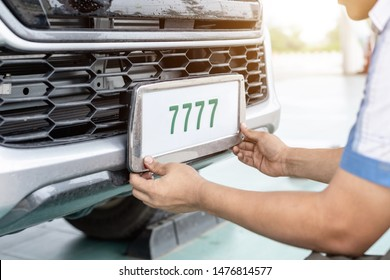 Technician changing Thailand car plate number in service center