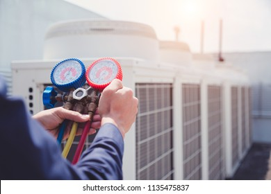 Technician is checking air conditioner ,measuring equipment for filling air conditioners. - Shutterstock ID 1135475837