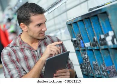 technician checking metal pieces