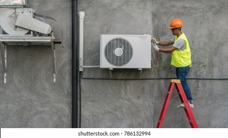 Technician is checking outdoor air conditioner unit