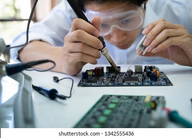 Technician checks the electronic device. Printed circuit board for the robot.
