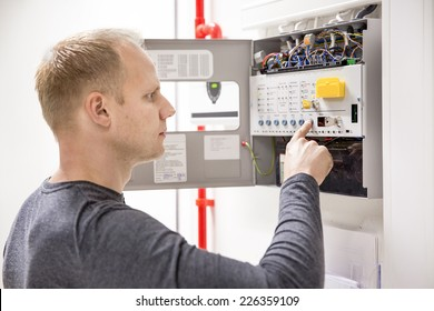 Technician checks fire panel in data center