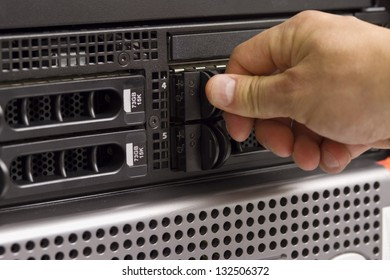 "IT technician / consultant insert / remove a hard disk from a rack server in a data center. This is a 3,5"" hard drive."