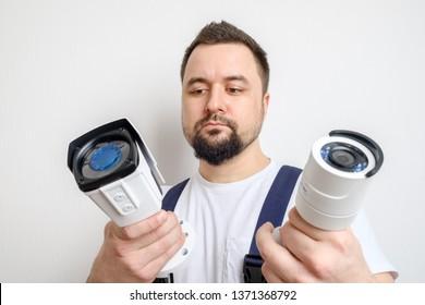 Technician or contractor choosing CCTV security camera