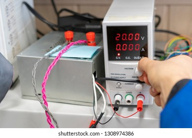 technician or engineer insert cords in power supply