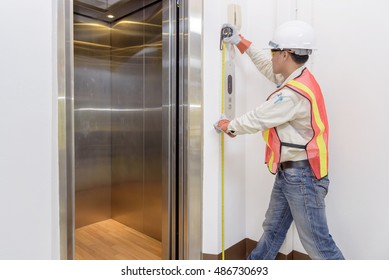 Technician - Engineer investigate work adjustment mechanism lifts the elevator.