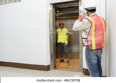 Technician - Engineer investigate work adjustment mechanism lifts the elevator.