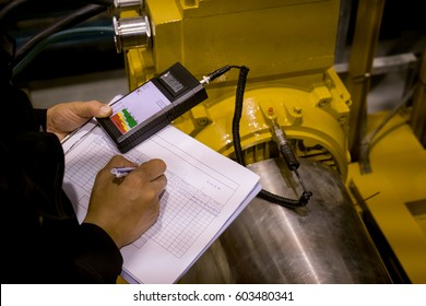 Technician or engineer recording data vibration measurement of motor or equipment in power plant