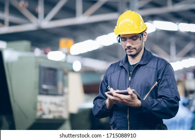 technician engineer standing and checking process on tablet in factory